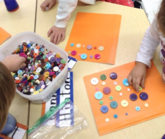 Making small, big, small, big patterns with buttons.